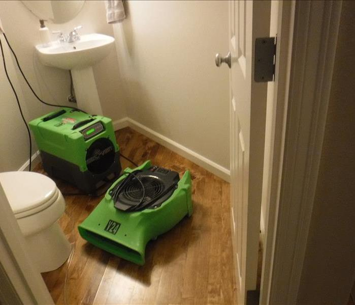 Sink, toilet, hard wood flooring and green equipment